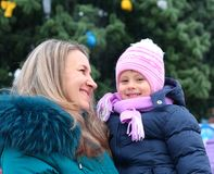 Mom and girl near a Christmas tree Royalty Free Stock Photos