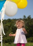Mom girl plays with balloons royalty free stock images