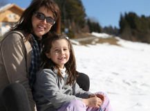Mom and girl in winter on sledge Stock Images