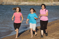 Mom girls running Stock Photo