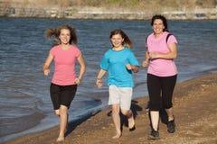 Mom girls running Stock Photo