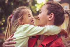 Mom give me a hug, little girl with mother. Leisure activity royalty free stock image