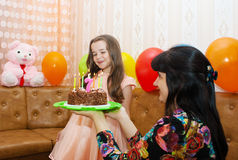 Mom gives daughter a birthday cake Stock Photography