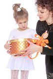 Mom gives a gift Royalty Free Stock Photography