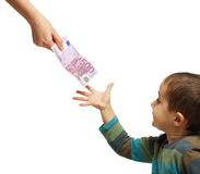 Mom gives pocket money to her son. Isolated on white royalty free stock photo