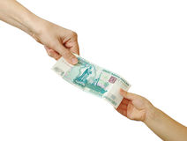 Mom gives pocket money to her son Royalty Free Stock Photos
