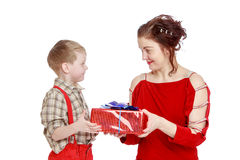 Mom gives son a gift. Happy family mother and son. Mom gives to his beloved son a gift . Closeup-Isolated on white background stock photo