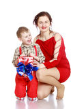 Mom gives son a gift Stock Photography