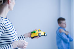 Mom giving toy car to her son Royalty Free Stock Photo
