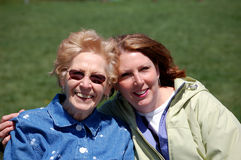 Mom and Gram at the Park. Two woman smiling while embracing Royalty Free Stock Photos