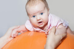 Mom with happy baby doing exercises at gymnastic ball Royalty Free Stock Photography