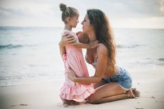 Mom and baby playing near beach. Traveling with family, child. Mom and happy baby playing near the beach. Traveling with your family, child. Games with child Royalty Free Stock Image