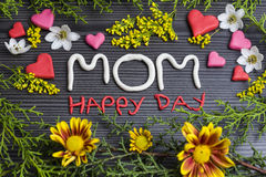 Mom happy day. Written with plasticine surrounded by flowers Royalty Free Stock Image