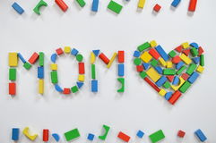 MOM and a heart with colorful wooden toy blocks Royalty Free Stock Image