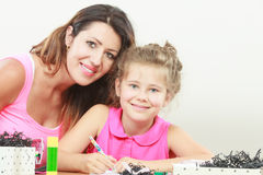 Mom helping daughter with homework Royalty Free Stock Photos