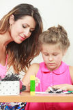 Mom helping daughter with homework Stock Photo