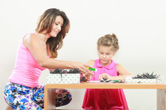 Mom helping daughter with homework Royalty Free Stock Photo