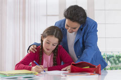 Mom helping her daughter do homework Royalty Free Stock Images