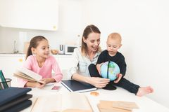 Mom helps my daughter do her homework in the kitchen. Royalty Free Stock Images