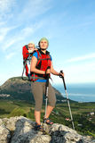 Mom and her child in the backpack. Royalty Free Stock Photography