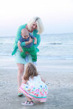 Mom with her children on the beach. Royalty Free Stock Image