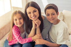 Mom and her children Stock Images