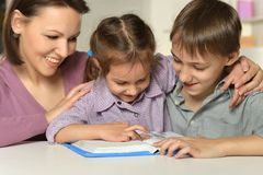 Mom with her children reading. A book Royalty Free Stock Photo