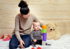 Mom and her Cute Baby Playing with Plastic Blocks Stock Photography