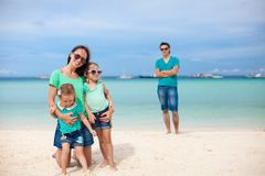 Mom with her cute daughters in the foreground and Royalty Free Stock Photography