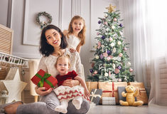 Mom and her cute daughters royalty free stock photos