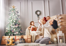 Mom and her cute daughters stock photography