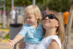 Mom and her cute little blond son Royalty Free Stock Photography