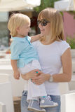 Mom and her cute little blond son Royalty Free Stock Photos