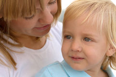 Mom and her cute little blond son Stock Photos