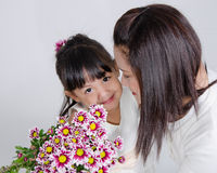 Mom and her Daughter. Love action by Mom and her Daughter in studio Royalty Free Stock Image