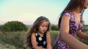 Mom with her daughter and the bike stock video footage