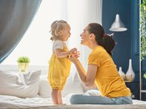 Mom and daughter are playing. Mom and her daughter child girl are playing, smiling and hugging. Family holiday and togetherness Stock Image
