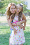 Mom and her daughter in the park Royalty Free Stock Photos