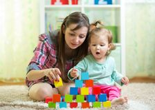 Mom with her daughter play together Stock Image