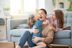 Mom and her daughters are playing royalty free stock images