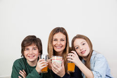 Mom with her kids having the breakfast Royalty Free Stock Images