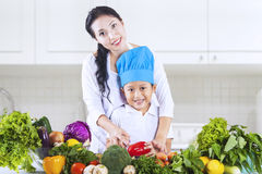Mom and chef boy in kitchen Royalty Free Stock Photo
