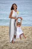 Mom and her little daughter happiness on the beach royalty free stock photo