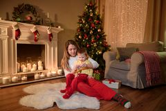 Mom with her son on her knees sitting on carpet royalty free stock photo