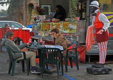 Mom and her son are sitting in cafe on open air. Verona, Italy - 26 November 2015: mom and her son are sitting in cafe on open air Royalty Free Stock Image