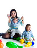 Mom and her twin sons Royalty Free Stock Image
