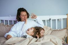 Mom and her two little cute daughters are having fun stock photos