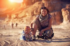 Mom and his little son are walking in the canyon. Mom and his little son are traveling in the canyon Royalty Free Stock Images