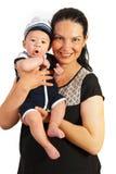 Mom holding amazed baby. Happy mother holding amazed baby boy in mariner suit isolated on white background Stock Photography