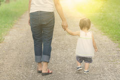 Mom holding hands her daughter warm tone, Concept for mother day. Royalty Free Stock Image
